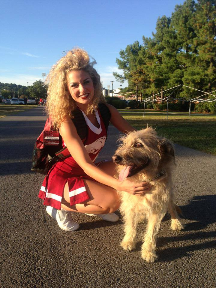Henri with Razorback cheerleader, Madelyn Gerald